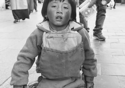 A Tibetan boy prostrating Jokhang Templeang Temple