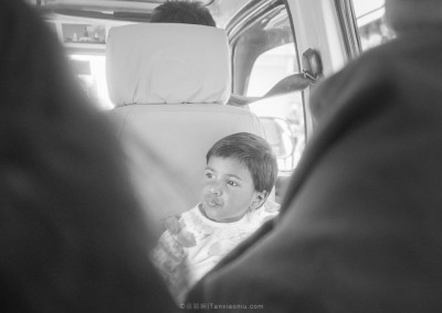 An Unfocused boy on a Microbus in Nepal