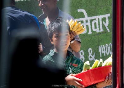 A Nepali Boy Selling Cucumbers at Zhangmu