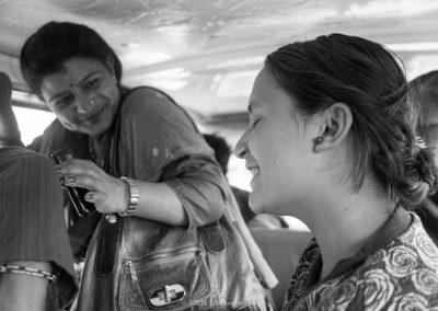 Elegant ladies on a Microbus in Kathmandu